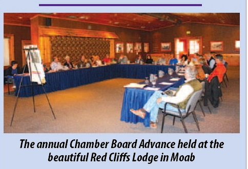 Photo that appeared in the Daily Sentinel showing the G.J. Chamber Board holding a meeting at a lodge in the next state. The photo was positioned underneath a survey showing local business owners wanted the chamber to promote shopping locally.